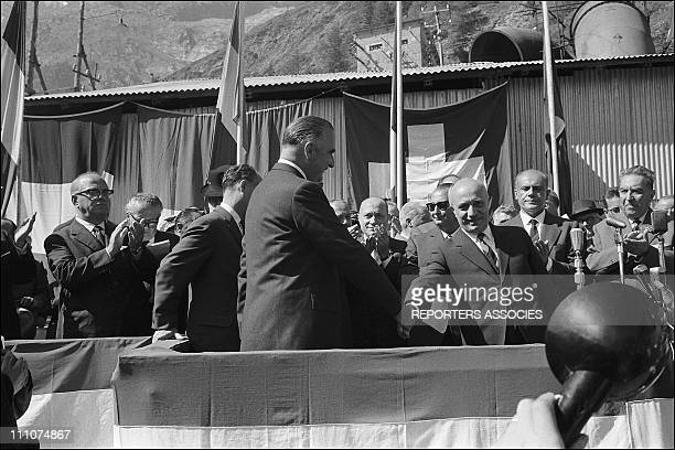 Inauguration of the tunnel between chamonix Mont Blanc and courmayeur French PM Georges Pompidou shakes hands with his Italian counterpart Amintore...