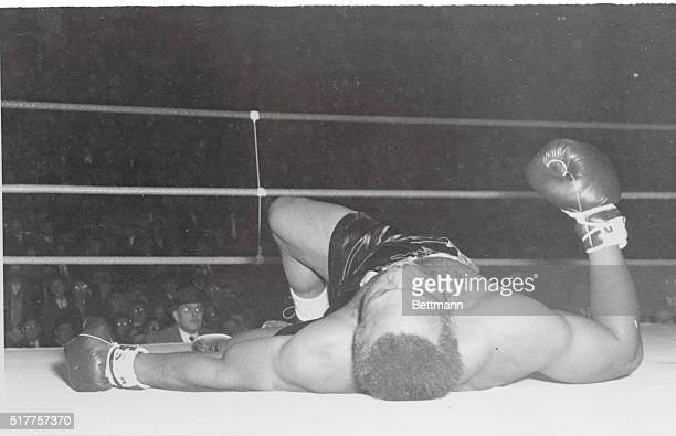 Inauspicious Beginning Montreal World LightHeavyweight champ Archie Moore lies on the canvas during one of the three times he was floored in round...