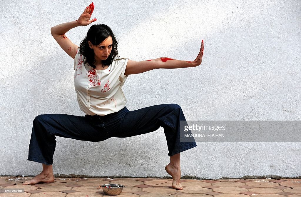 Inbal Oshman, 32-year-old contemporary dancer from Israel, performs during a preview of 'Attakkalari India Biennial 2013' dance festival in Bangalore on January 10, 2013. The ten-day biennial organised by Attakkalari Centre for Movement Arts, features contemporary dance choreographers, thinkers and performance art practitioners from across the world to display their experiments in the field of dance. AFP PHOTO/Manjunath KIRAN
