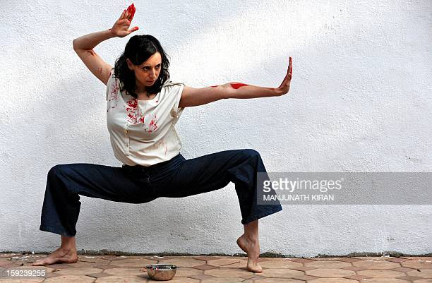 Inbal Oshman 32yearold contemporary dancer from Israel performs during a preview of 'Attakkalari India Biennial 2013' dance festival in Bangalore on...