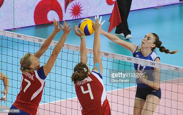 Inbar Vinarsky of Israel spikes the ball against Ivana Plchotova and Aneta Havlickovai of Czech Republic during the Women's Volleyball European...