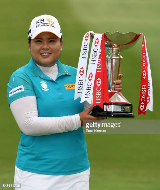 Inbee Park of Korea celebrates on the 18th green with the winners trophy after the final round of the HSBC Women's Champions on the Tanjong course at...