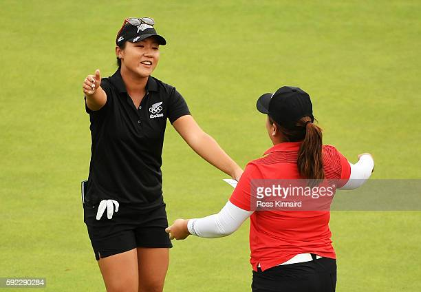 Inbee Park of Korea gold celebrates with Lydia Ko of New Zealand silver on the 18th green after the Women's Golf Final on Day 15 of the Rio 2016...