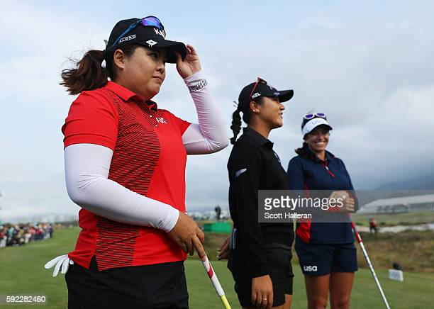 Inbee Park of Korea Lydia Ko of New Zealand and Gerina Piller of the United States are introduced on the first tee during the Women's Golf Final on...