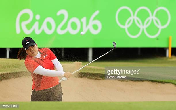 Inbee Park of Korea plays a shot from a bunker on the 18th hole during the Women's Golf Final on Day 15 of the Rio 2016 Olympic Games at the Olympic...