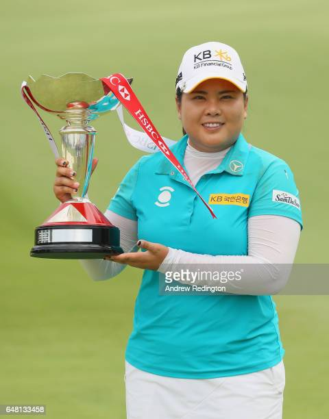 Inbee Park of Korea poses with the trophy after winning the HSBC Women's Champions on the Tanjong Course at Sentosa Golf Club on March 5 2017 in...