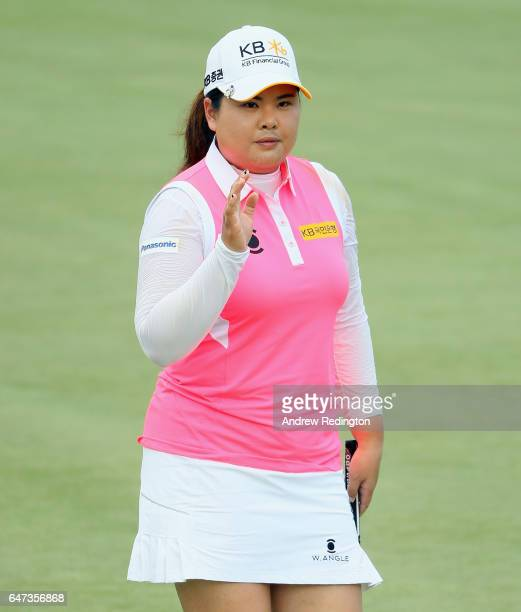 Inbee Park of Korea waves to the crowd after a birdie on the 18th hole during the second round of the HSBC Women's Champions on the Tanjong Course at...