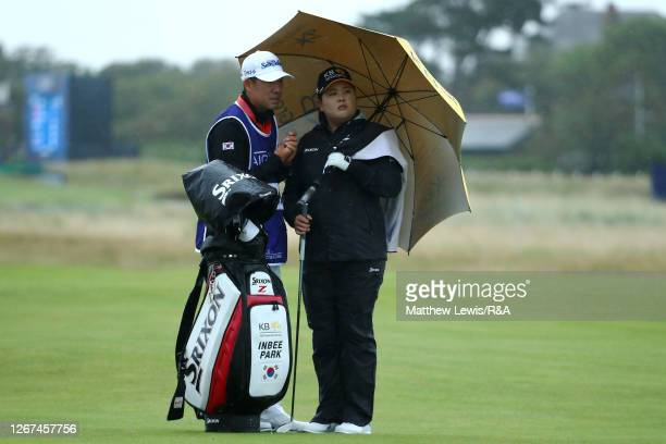 Inbee Park of South Korea and caddie Gi Hyeob Nam look on from the 2nd fairway during Day Two of the AIG Women's Open 2020 at Royal Troon on August...