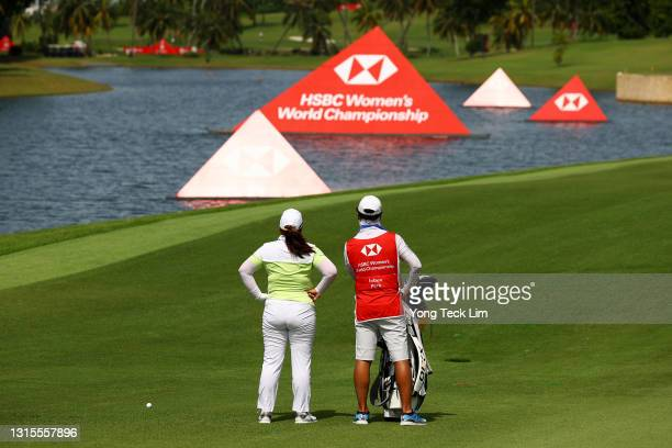 Inbee Park of South Korea and her husband and caddie Gi Hyeob Nam look on from the fifth fairway during the third round of the HSBC Women's World...
