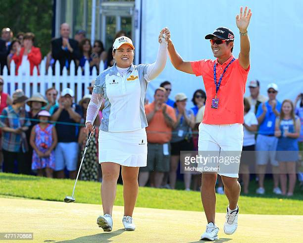 Inbee Park of South Korea and her husband Gi Hyeob Nam celebrate her win on the 18th green during the fourth and final round of the KPMG Women's PGA...