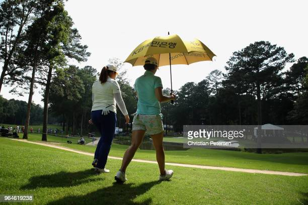 Inbee Park of South Korea and In Gee Chun of South Korea walk the eighth hole during the first round of the 2018 U.S. Women's Open at Shoal Creek on...