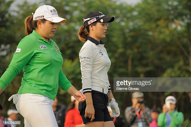 Inbee Park of South Korea and So Yeon Ryu of South Korea walk on the 18th fairway during the first round of the Reignwood LPGA Classic at Pine Valley...