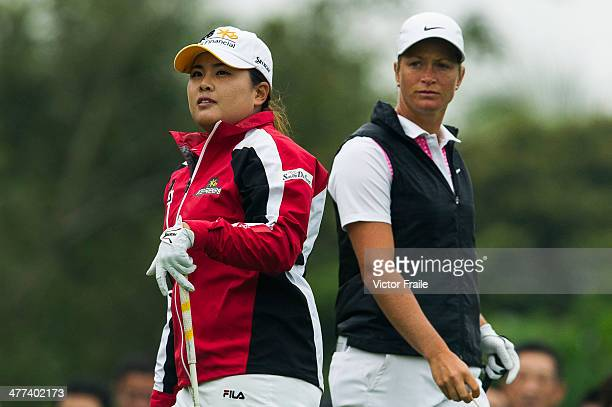 Inbee Park of South Korea and Suzann Pettersen of Norway wait to play on the 7th tee during the Round 4 of the World Ladies Championship at Mission...