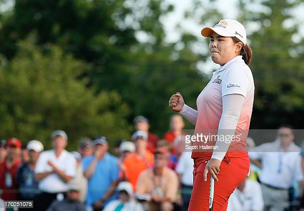 Inbee Park of South Korea celebrates after defeating Catriona Matthew on the third playoff hole during the final round of the Wegmans LPGA...