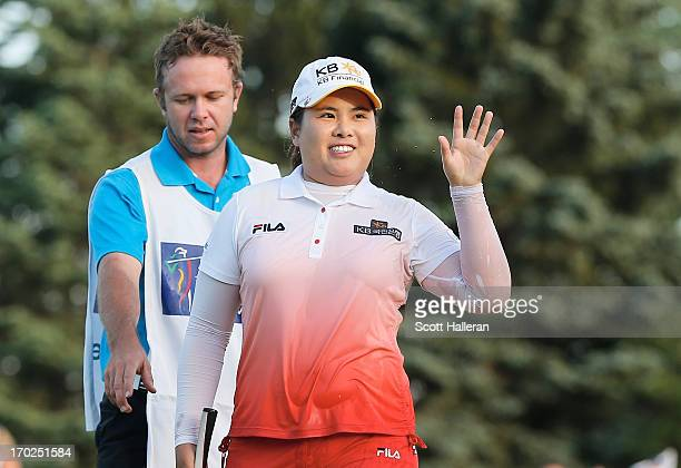 Inbee Park of South Korea celebrates after defeating Catriona Matthew on the third playoff hole alongside her caddie Brad Beecher during the final...