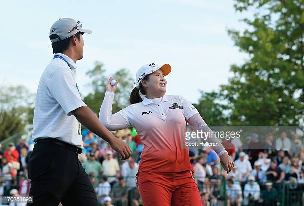 Inbee Park of South Korea celebrates after defeating Catriona Matthew on the third playoff hole alongside her coach and fiance, Gihyeob Nam during...