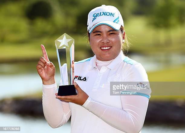 Inbee Park of South Korea celebrates after sinking a birdie putt during the final round to win the 2013 North Texas LPGA Shootout at the Las Colinas...