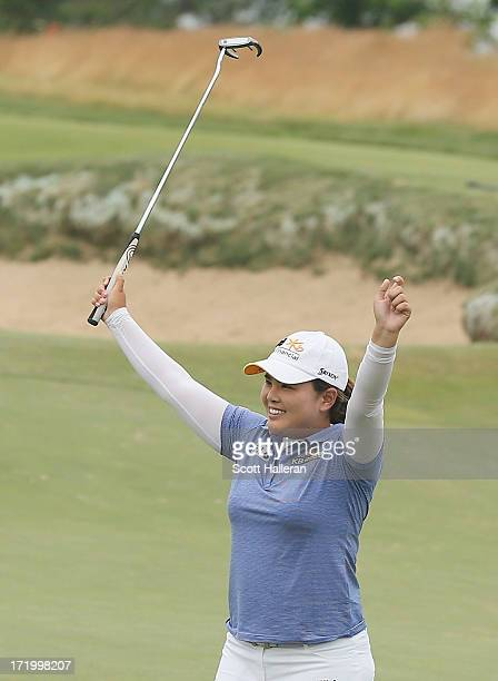 Inbee Park of South Korea celebrates on the 18th green after her four-stroke victory at the 2013 U.S. Women's Open at Sebonack Golf Club on June 30,...