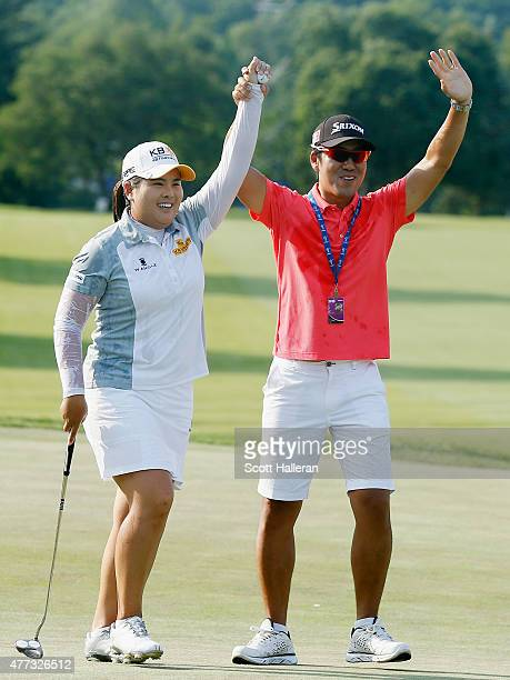 Inbee Park of South Korea celebrates on the 18th green with her husband Gi Hyeob Nam after her five-stroke victory at the KPMG Women's PGA...