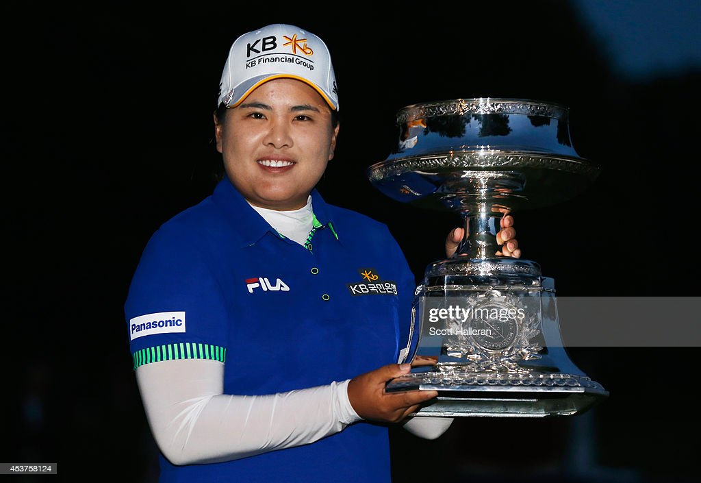 Inbee Park of South Korea celebrates with the trophy after winning theWegmans LPGA Championship at Monroe Golf Club on August 17, 2014 in Pittsford, New York.
