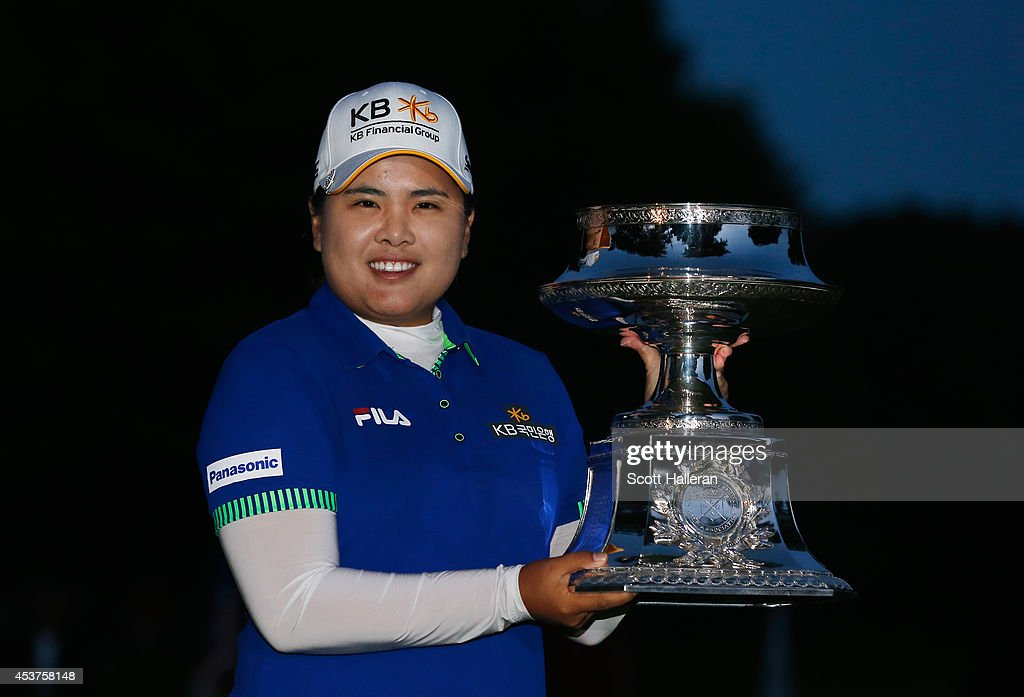 Inbee Park of South Korea celebrates with the trophy after winning the Wegmans LPGA Championship at Monroe Golf Club on August 17, 2014 in Pittsford, New York.