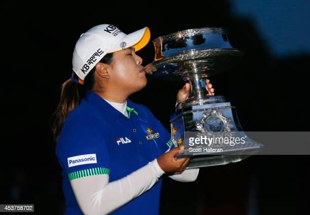 Inbee Park of South Korea celebrates with the trophy after winning theWegmans LPGA Championship at Monroe Golf Club on August 17 2014 in Pittsford...