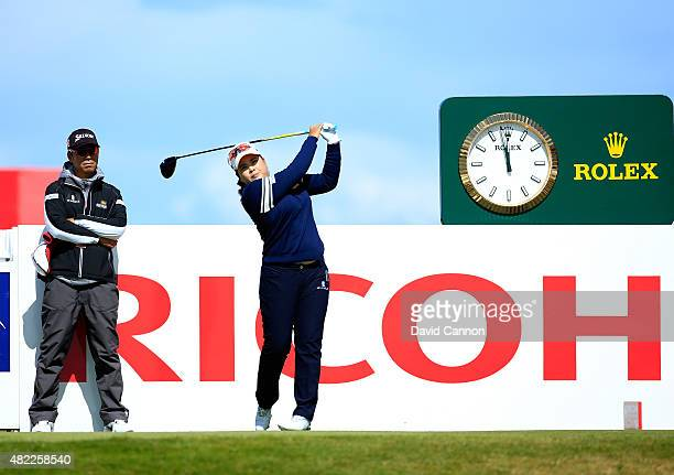 Inbee Park of South Korea in action during her final practice round watched by her swing coach and husband Gi Hyeob Nam as a preview for the 2015...