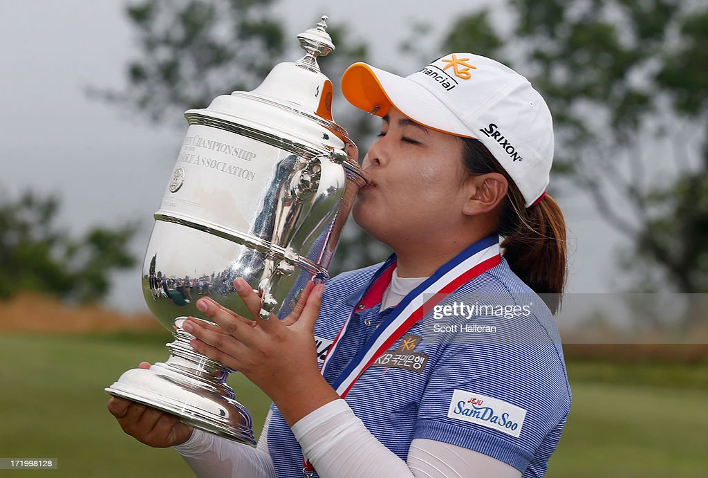 Inbee Park of South Korea kisses the trophy after her four-stroke victory at the 2013 U.S. Women's Open at Sebonack Golf Club on June 30, 2013 in Southampton, New York. Park has now won three consecutive major championships.