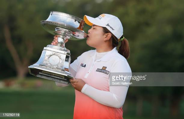 Inbee Park of South Korea kisses the trophy after winning the Wegmans LPGA Championship at Locust Hill Country Club on June 9, 2013 in Pittsford, New...