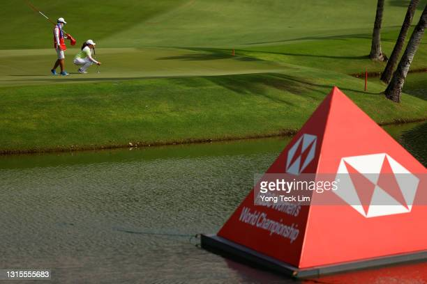 Inbee Park of South Korea lines up her putt with her husband and caddie Gi Hyeob Nam on the second green during the third round of the HSBC Women's...