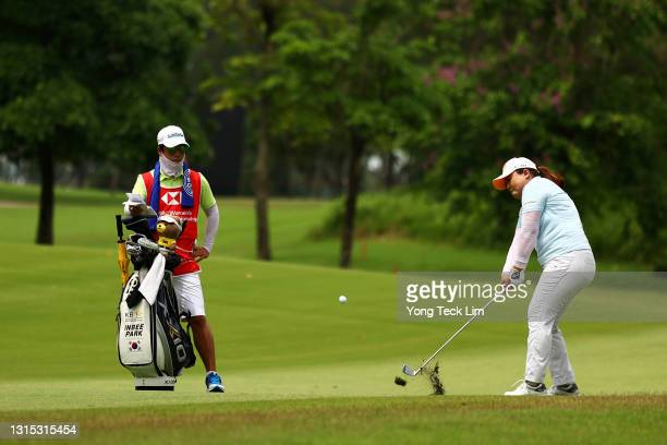 Inbee Park of South Korea plays her second shot from the 10th fairway as her husband and caddie Gi Hyeob Nam looks on during the second round of the...