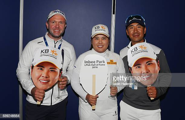 Inbee Park of South Korea poses with her caddie Brad Beecher and her husband and coach Gi Hyeob Nam after she gained entry in the LPGA Hall of Fame...