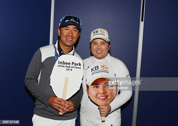 Inbee Park of South Korea poses with her husband and coach Gi Hyeob Nam after she gained entry in the LPGA Hall of Fame after finishing the first...