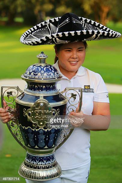 Inbee Park of South Korea poses with the champions trophy after the final round of Lorena Ochoa Invitational 2015 at the Club de Golf Mexico on...