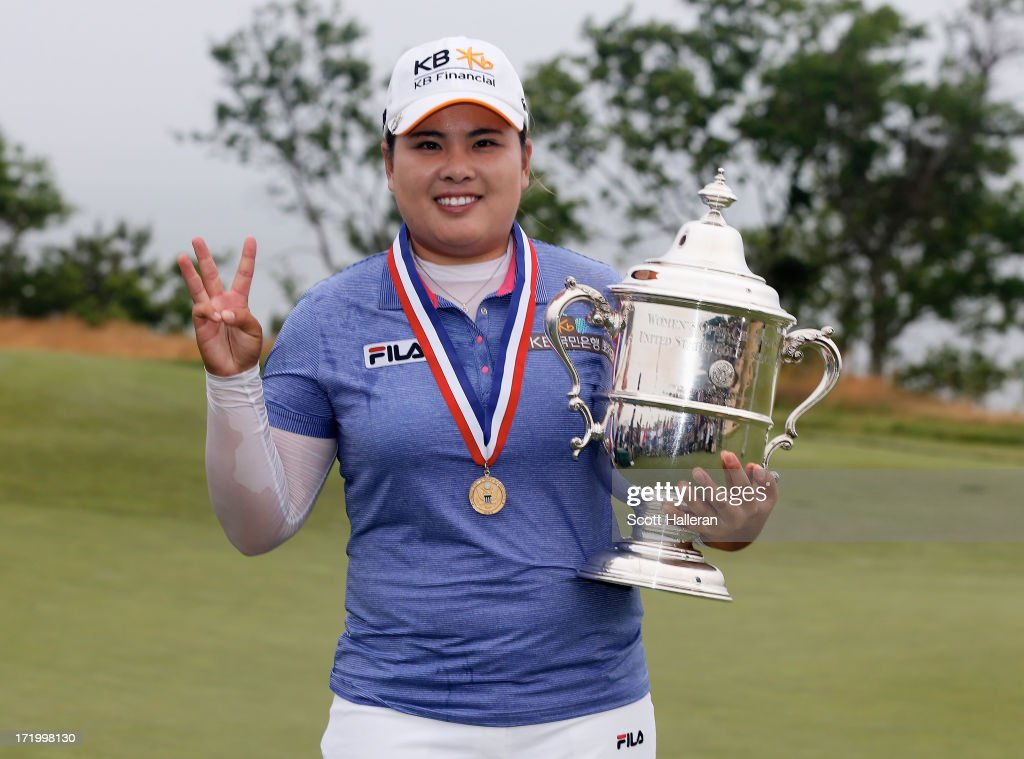 Inbee Park of South Korea poses with the trophy after her four-stroke victory at the 2013 U.S. Women's Open at Sebonack Golf Club on June 30, 2013 in Southampton, New York. Park has now won three consecutive major championships.