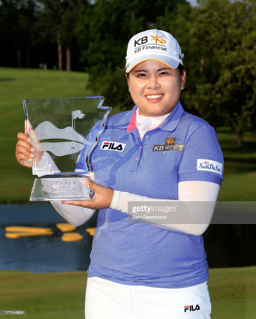 Inbee Park of South Korea poses with the trophy after winning the Walmart NW Arkansas Championship Presented by P&G at the Pinnacle Country Club on June 23, 2013 in Rogers, Arkansas.