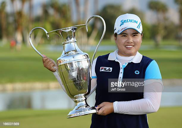 Inbee Park of South Korea poses with the trophy after winning the Kraft Nabisco Championship at Mission Hills Country Club on April 7 2013 in Rancho...