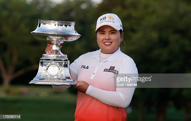 Inbee Park of South Korea poses with the trophy after winning the Wegmans LPGA Championship at Locust Hill Country Club on June 9, 2013 in Pittsford,...
