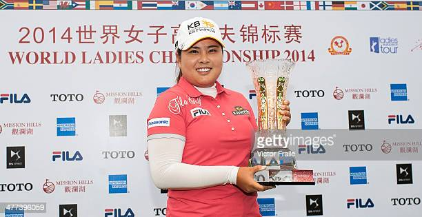 Inbee Park of South Korea poses with the trophy after winning the World Ladies Championship at Mission Hills' Blackstone Course on March 9 2014 in...