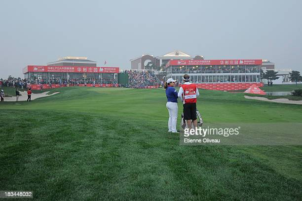 Inbee Park of South Korea prepares her approach on the 18th during the final round of the Reignwood LPGA Classic at Pine Valley Golf Club on October...