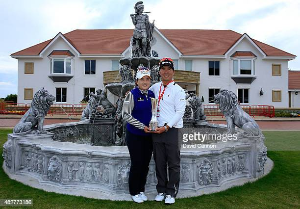 Inbee Park of South Korea proudly holds the trophy outside the Clubhouse with her husband Gi Hyeob Nam after her victory in the 2015 Ricoh Women's...