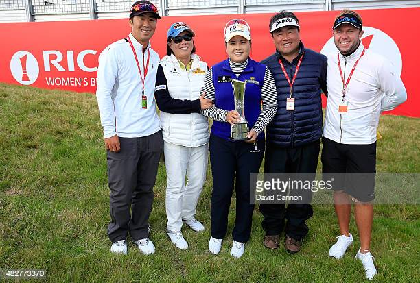 Inbee Park of South Korea proudly holds the trophy with her mother Sung Kim Park and father Gun Gyu Park, her husband Gi Hyeob Nam and her caddie...