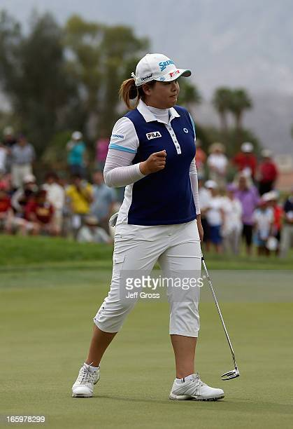Inbee Park of South Korea reacts after making a birdie putt on the second hole during the final round of the Kraft Nabisco Championship at Mission...