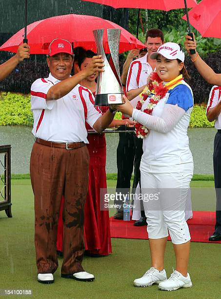 Inbee Park of South Korea receives the Sime Darby LPGA Trophy from the Deputy Prime Minister of Malaysia Tan Sri Muhyiddin Yassin after she won it 15...