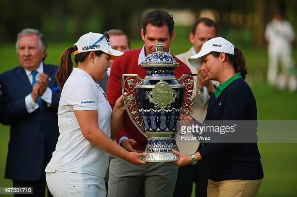 Inbee Park of South Korea receives the trophy from Lorena Ochoa of Mexico after the final round of Lorena Ochoa Invitational 2015 at the Club de Golf...