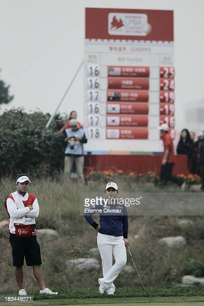 Inbee Park of South Korea wait with her caddie in front of the leader board during the final round of the Reignwood LPGA Classic at Pine Valley Golf...