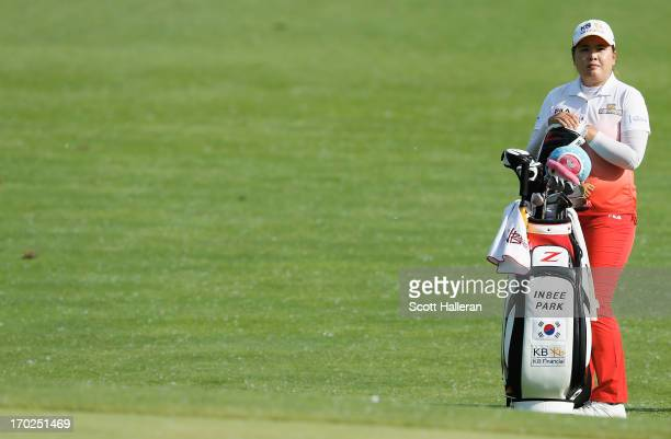 Inbee Park of South Korea waits on the 13th hole during the final round of the Wegmans LPGA Championship at Locust Hill Country Club on June 9, 2013...