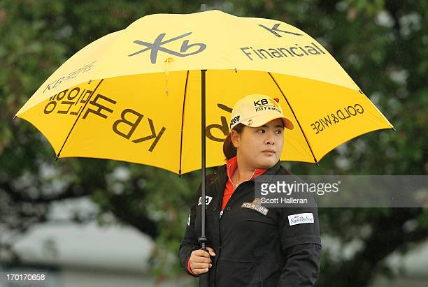 Inbee Park of South Korea waits on the practice green during the weather-delayed second round of the Wegmans LPGA Championship at Locust Hill Country...