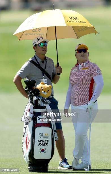 Inbee Park of South Korea waits with her husband Gi Hyeob Nam her second shot on the 12th hole during the pro-am as a preview for the 2018 ANA...