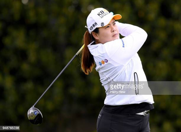 Inbee Park of South Korea watches her shot on the 14th tee during round one of the HugelJTBC Championship at the Wilshire Country Club on April 19...